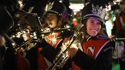 The Northville High School marching band, seen here in 2016, will again appear in downtown Northville's Holiday Lighted Parade on Friday.
