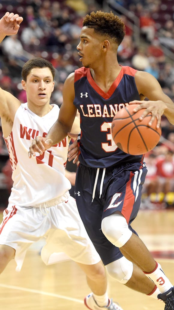 Lebanon's Allan Escoto looks inside during the matchup with Wilson. The Lebanon Cedars fell to Wilson 55-39 at the Giant Center in Hershey, Feb. 20 in the 2016 District III Basketball Championships.