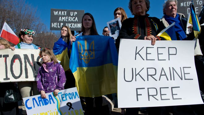 People hold signs and flags during a protest against ousted Ukrainian President Viktor Yanukovych in front of the White House in Washington on Feb. 23.