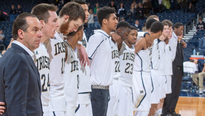 Notre Dame coach Mike Brey stands with his players before a game earlier this season.