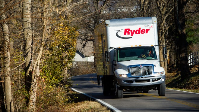 A box truck drives along a windy stretch of Kansas Road between Indiana 57 and Old Petersburg Road in Evansville, Thursday, Dec. 8, 2016.