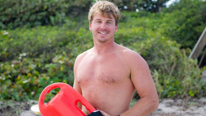 Palm Beach County Ocean Rescue lifeguard Russ Gehweiler Jr., pictured, was on his lunch break at Ocean Cay Park tower when notified by his lieutenant, Philip Harris, that there was a whale trying to beach itself 10 yards off shore.