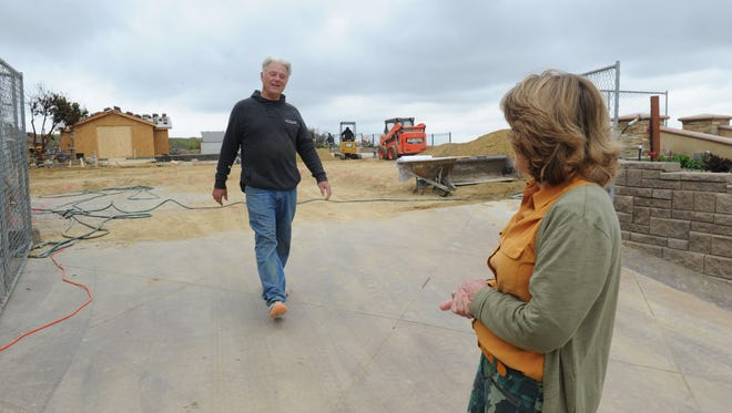 Ed Fuller meets his wife after working on digging the foundation of their property that was destroyed by the Thomas Fire. They live in the Ondulando neighborhood in Ventura and are the first household to get a building permit.