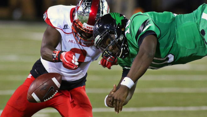 Oct 15, 2015; Denton, TX, USA;  Mean Green quarterback DaMarcus Smith (10) fumbles as he is hit by Western Kentucky Hilltoppers defensive back Marcus Ward (8) and North Texas recovered the ball during the second quarter of game at Apogee Stadium. Mandatory Credit: Ray Carlin-USA TODAY Sports