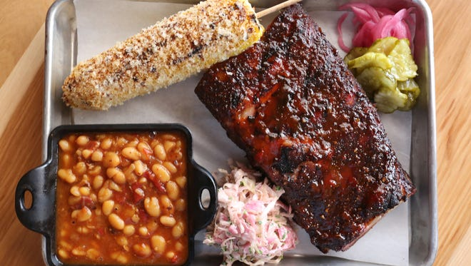 Bourbon glazed pork ribs with baked beans and corn, at Red Barn Kitchen. Aug 9, 2016.