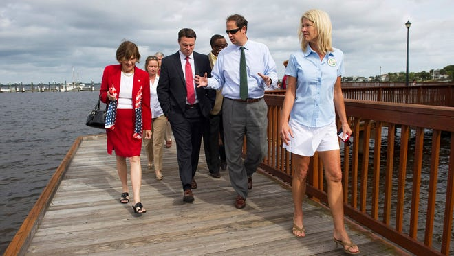 Sen. Joe Negron (second from right) gives Florida House Speaker Will Weatherford (second from left) a tour of the Indian River Lagoon with Florida Reps. Gayle Harrell (left) and Debbie Mayfield (right) along the Riverwalk in downtown Stuart on Nov. 11, 2013.
