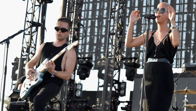 INDIO, CA - APRIL 13:  Musicians Alisa Xayalith (R) and Thom Powers of The Naked and Famous perform onstage during day 3 of the 2014 Coachella Valley Music & Arts Festival at the Empire Polo Club on April 13, 2014 in Indio, California.  (Photo by Kevin Winter/Getty Images for Coachella)