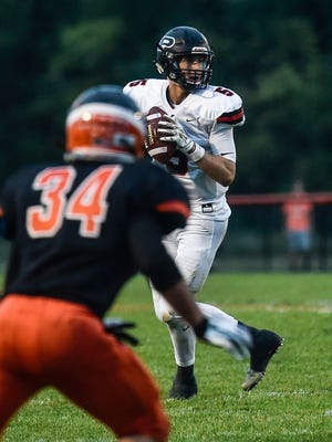 Pleasant quarterback Joe Craycraft drops back to pass against North Union as Drake Price drops into coverage. Craycraft signed to play football at Youngstown State Wednesday morning.