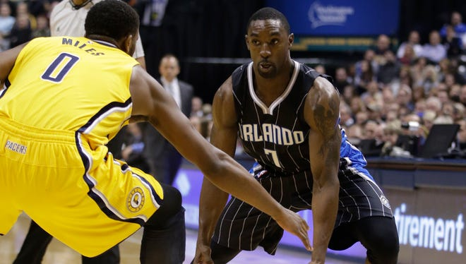 Orlando Magic guard Ben Gordon is defended by the Indiana Pacers on Nov. 28, 2014, in Indianapolis.