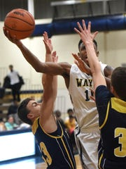Wayne's Keion Epps (middle) slices in for the layup