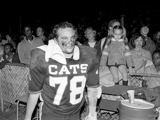 Overton High senior tackle Stan Williams (78) is showing the signs of the battle in the trenches during their 28-26 win over Father Ryan High at home Oct. 30, 1981.