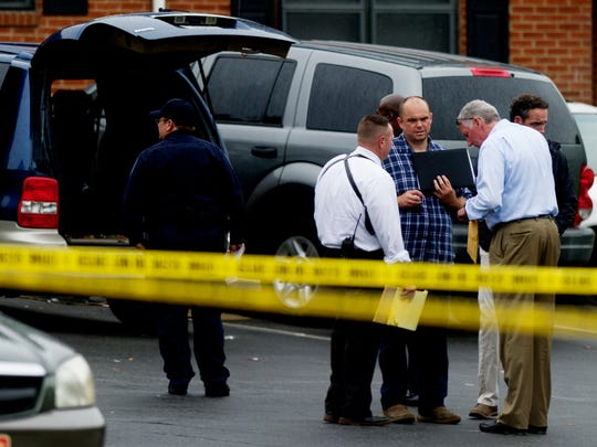 Investigators at the scene of a triple shooting at Montgomery Village Apartments in South Knoxville, Tennessee on Thursday, June 22, 2017. Three individuals were reported shot and one killed.