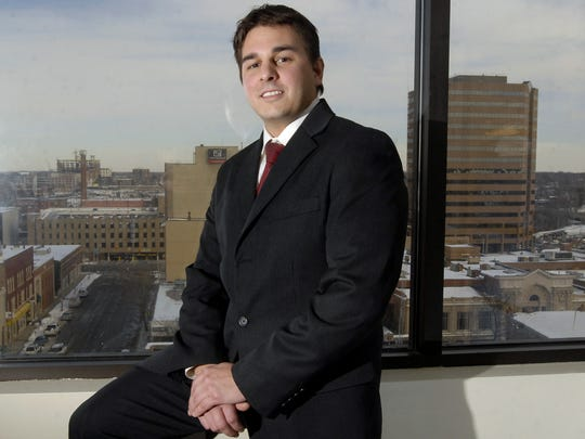 Spartan Internet founder Ryan Vartoogian in his office in downtown  Lansing in 2007, the year he bought the former Holmes Street School.