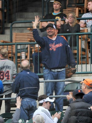 Bill Dugan of Roseville shows that he caught five foul balls during Monday's game at Comerica Park.