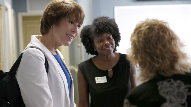 In this file photo, then U.S. Rep. Gwen Graham chats with Capitol Area Healthy Start employees, including then Executive Director Kristy Goldwire, center.