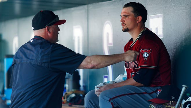Arizona Diamondbacks pitching coach Mike Butcher, left, said staff maturity and catcher experience and stability played a role in the team's improvement on the mound.
