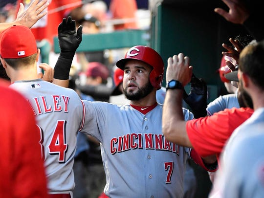 Cincinnati Reds third baseman Eugenio Suarez (7) is congratulated by teammates after hitting a solo homer against the Washington Nationals during the fourth inning at Nationals Park.