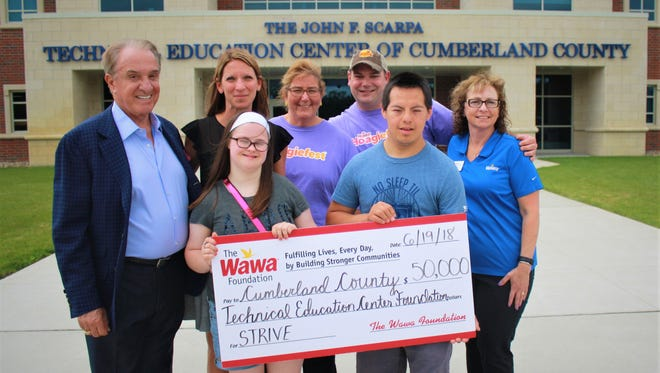(Front row, from left) Daniel Fomich of Millville, STRIVE student, Cumberland County Technical Education Center; and Tabitha Cheesman of Bridgeton, STRIVE student, CCTEC; and (back row, from left) John F. Scarpa, major donor; Dina Rossi Elliott, superintendent, CCTEC; Terry Bova, general manager, Wawa No. 964 on Second Street in Millville; Matt Storar, general manager, Wawa No. 924 at Sherman Avenue and Delsea Drive in Vineland; and Sherri Caterina, area manager for Vineland and Millville; are pictured at a check presentation. The Wawa Foundation donated $50,000 to the John F. Scarpa Technical Education Center of Cumberland County's STRIVE (Students Training Rigorously In Vocational Education) program.