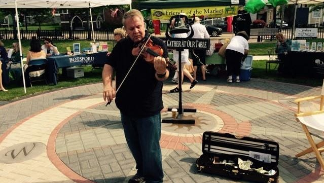 """Violinist Anthony Marchese played at the Farmington Farmers Market's inaugural """"Fit as a Fiddle"""" health awareness fair in Riley Park."""
