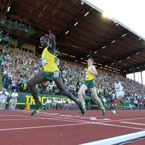 Jun 12, 2015; Eugene, OR, USA; Edward Cheserek and Eric Jenkins of Oregon celebrate after finishing first and second in the 5,000m in 13:48.67 and 13:48.92 in the 2015 NCAA Track & Field Championships at Hayward Field. Mandatory Credit: Kirby Lee-USA TODAY Sports