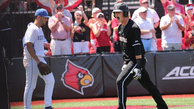 U of L's Tyler Fitzgerald (2) celebrated after sliding in at home plate as he was knocked in by Logan Taylor (24) during the super regional at Patterson Stadium.June 10, 2017