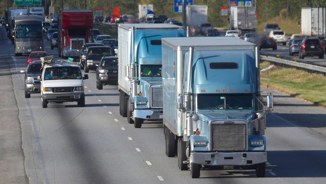 Trucks travel along Interstate 75 near Stockbridge,