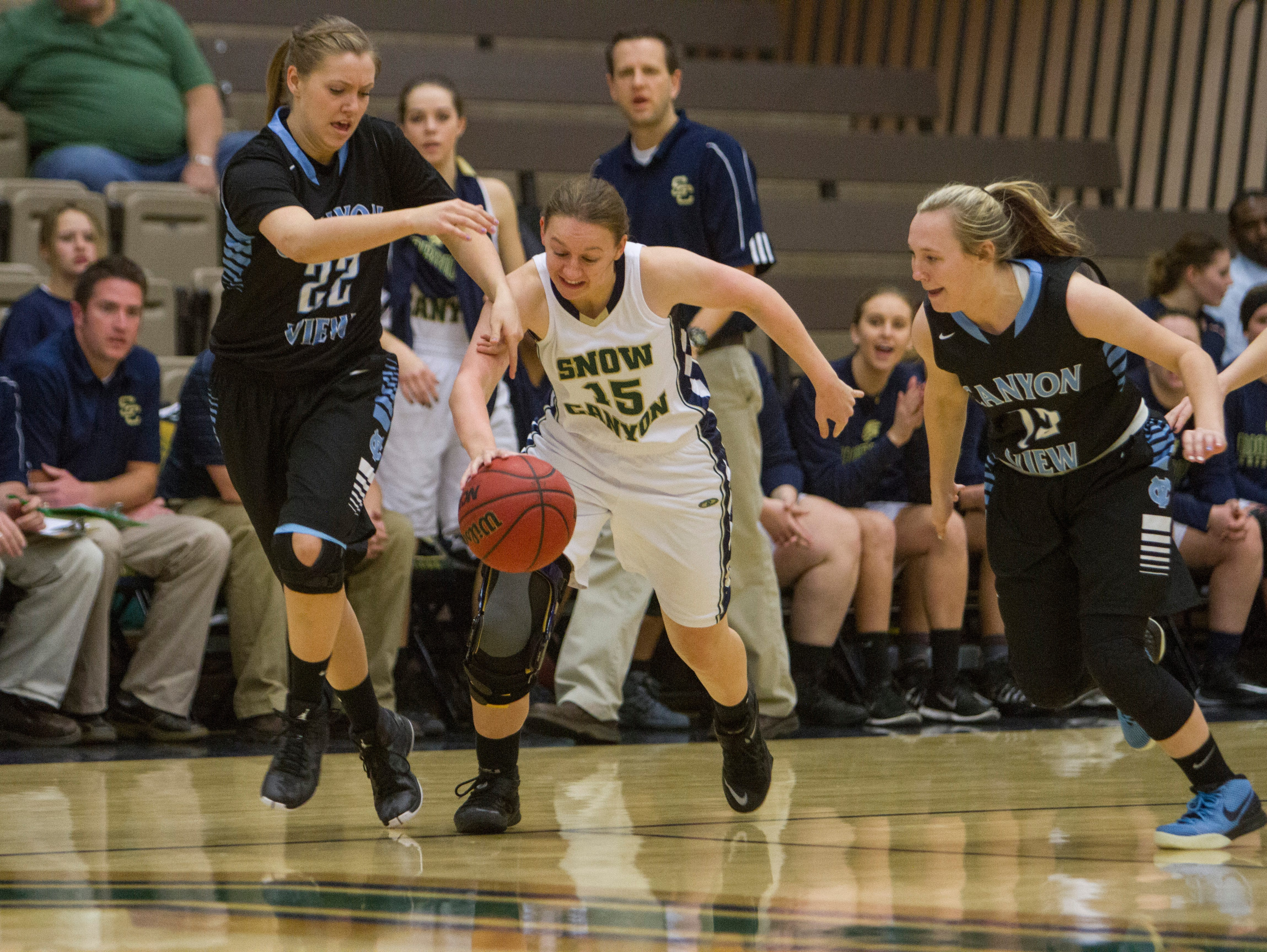 Snow Canyon's Natalie Coulam dribbles through traffic against Canyon View on Thursday in St. George. Coulam worked through an ACL injury to be a part of this year's team.