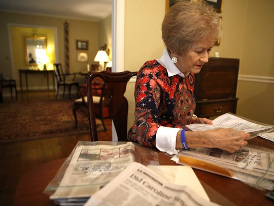 Karen McGehee looks over newspaper clippings, legal filings and her own notes of her daughter Caroline's death, at her Tallahassee home.
