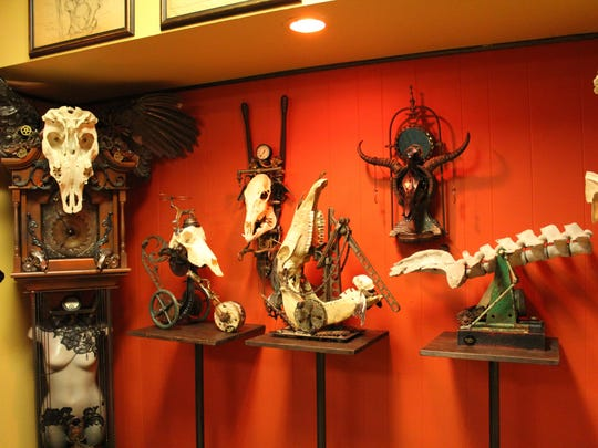 Some of Sue Moerder's sculptures that are on display at her shop Moerder Tattoos and Gallery.
