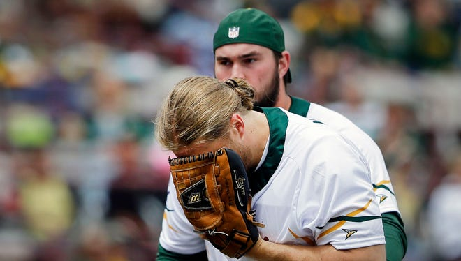Clay Matthews is hit by a line drive as he pitches during the Green & Gold Charity Softball Game Saturday, June 2, 2018, at Neuroscience Group Field at Fox Cities Stadium in Grand Chute, Wis. The game benefits the Jordy Nelson-backed Young Life organization. The former Packer led the event beginning in 2014.