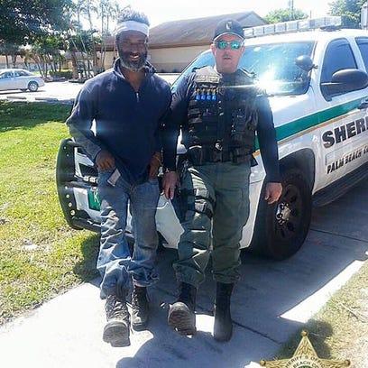 Palm Beach County Sheriff's deputy with man who he