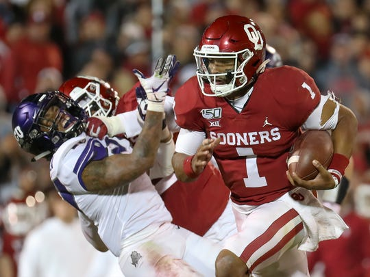 Nov 23, 2019; Norman, OK, USA; Oklahoma Sooners quarterback Jalen Hurts (1) runs past TCU Horned Frogs cornerback Kee'yon Stewart (2) during the second half at Gaylord Family - Oklahoma Memorial Stadium. Mandatory Credit: Kevin Jairaj-USA TODAY Sports