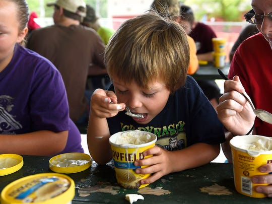 Five-year-old Jesse Walters of Knoxville competes in the ice cream eating contest Monday, Sept. 8, 2014, at the Tennessee Valley Fair. Sponsored by Mayfield Dairy Farms, the contest was won by Leonard Kirkland of Sweetwater, who finished three pints of ice cream in three minutes.
