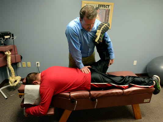 PHOTOS: Chiropractors see up tic in patients due to shoveling