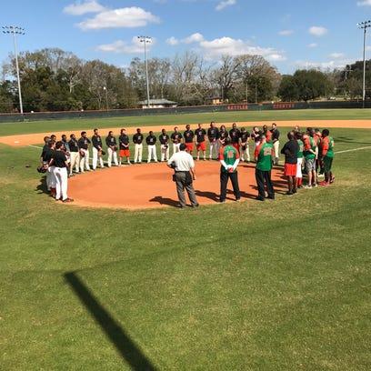 The FAMU baseball team and alumni observe a moment