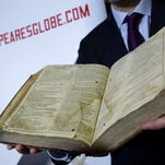 The recently discovered Saint-Omer First Folio is pictured during a photocall at Shakespeare's Globe in London on February 23.