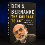In this photo taken Oct. 1, 2015, Former Federal Reserve Chairman Ben Bernanke's new book on the financial crisis is photographed in Washington. Bernanke says the U.S. economy is outperforming Europe at the moment because the Fed moved more quickly and aggressively to fight the 2008 financial crisis than Europe did.