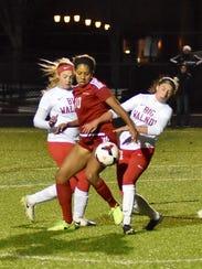 Morgan Jackson (10) fights through the defense of Big