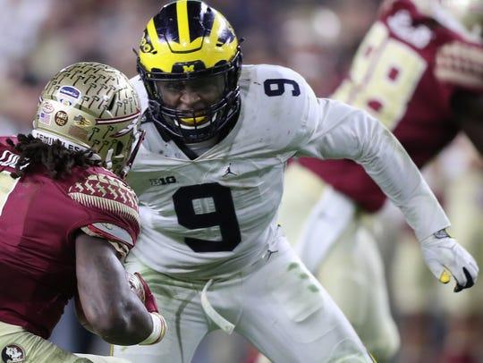 Michigan linebacker Mike McCray tackles Florida State