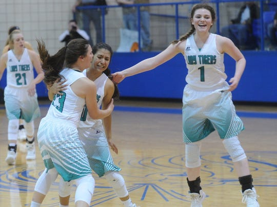 May's Roberta Robinette, left, celebrates with Yary Rodriguez, center, and Kelsey Chambers after the Lady Tigers beat Roby 48-41 in a Region II-1A quarterfinal playoff game Tuesday, Feb. 20, 2018 in Winters.