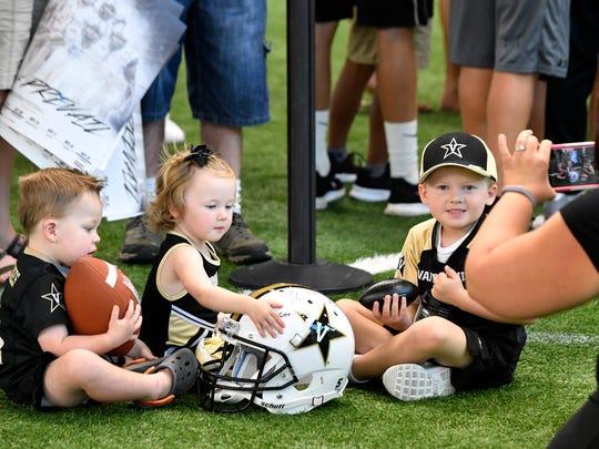 Bennett, Baylor, and Beckham Byrd have their photo taken by their mom Ashley at the Vanderbilt football Dore Jam fan event.Saturday Aug. 5, 2017, in Nashville, TN