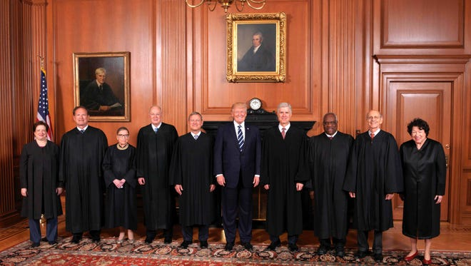 President Trump, here with his nominee, Justice Neil Gorsuch, and the rest of the Supreme Court, may have a lasting impact on the federal judiciary.