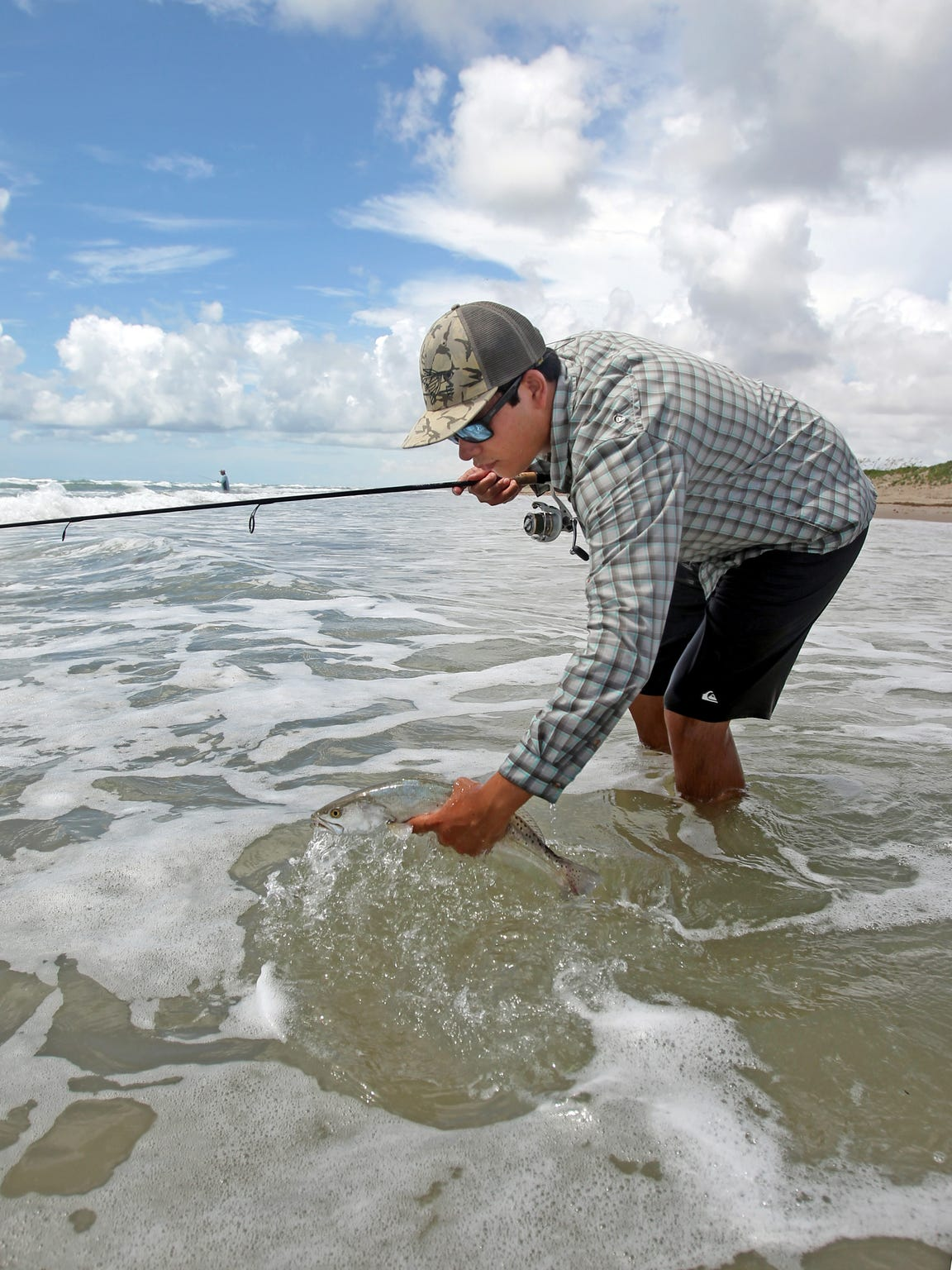 Summer trout fishing along Padre Island beaches can