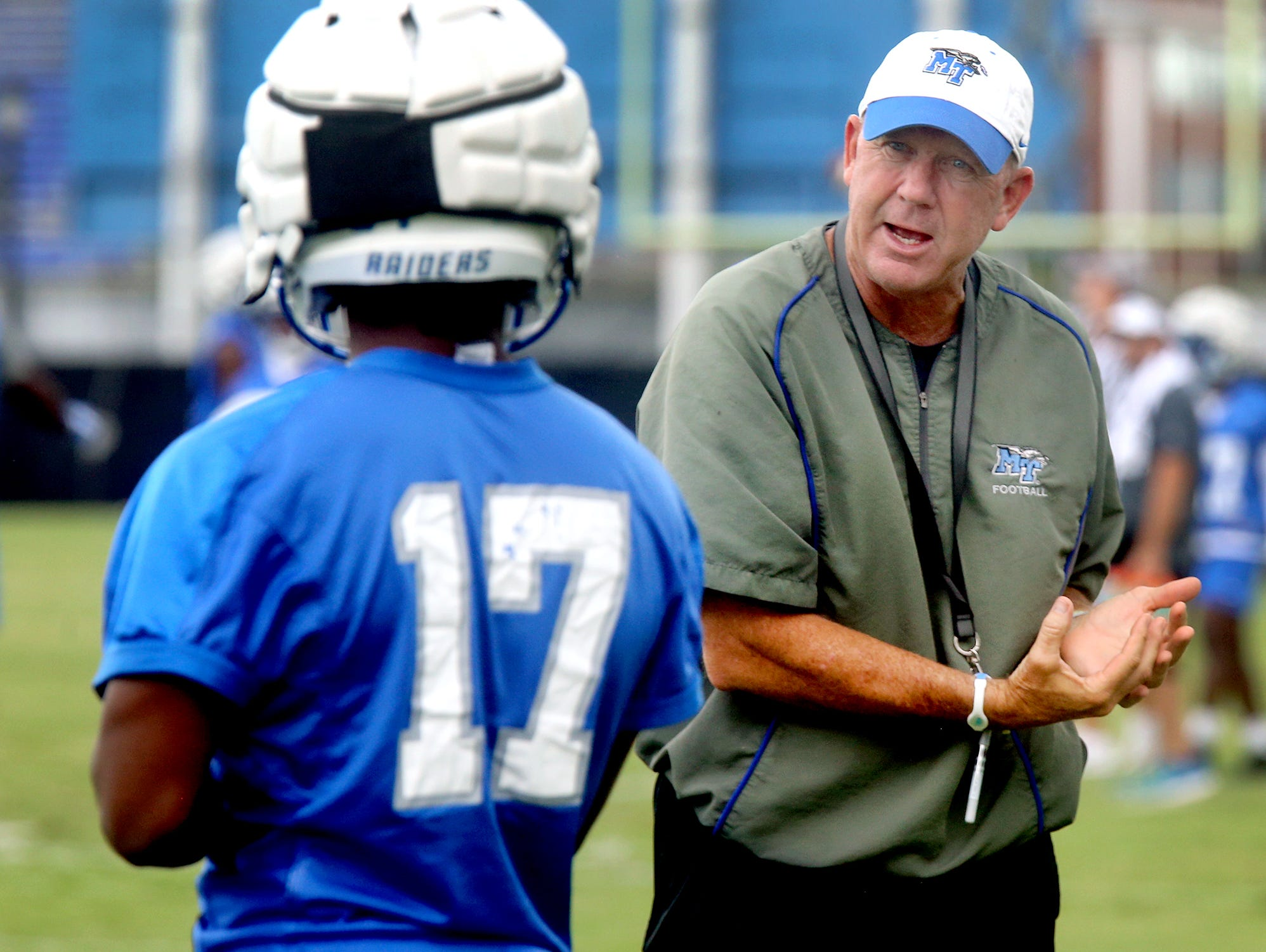 MTSU's Head Coach Rick Stockstill works with Kylan Stribling (17) during practice, on Tuesday, Aug. 1, 2017.