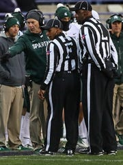 Head coach Mark Dantonio of the Michigan State Spartans argues a spot call with referees during a game against the Northwestern Wildcats at Ryan Field on October 28, 2017 in Evanston, Illinois. Northwestern defeated Michigan State 39-31 in triple overtime.
