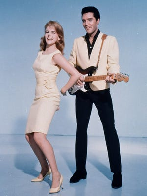 "Elvis Presley and Ann-Margret are shown in an MGM Studios publicity photo for the 1964 film ""Viva Las Vegas."""