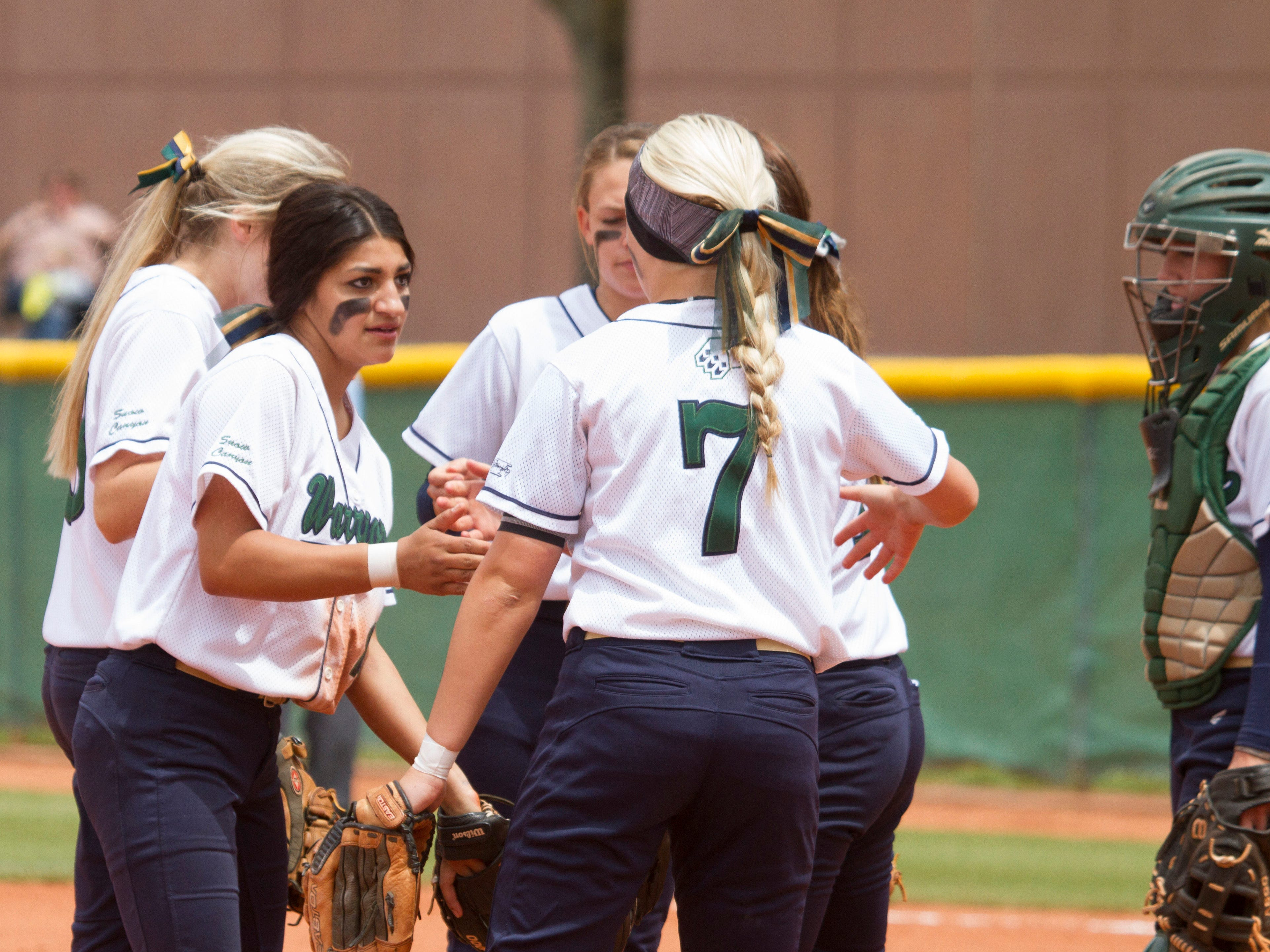 Snow Canyon softball players cheer each other on against Morgan on Saturday.