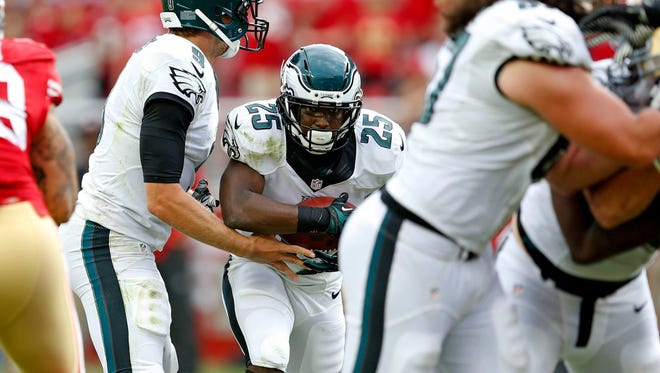 Eagles running back LeSean McCoy takes a hand-off from Eagles quarterback Nick Foles during the fourth quarter against the 49ers on Sunday.