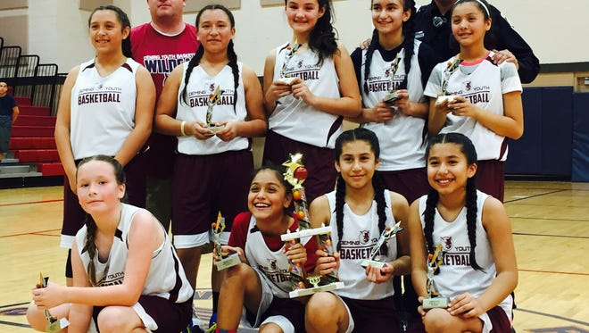 The Dispy Dos won the championship of the Deming Junior Basketball League in the fourth- through six-grade division. The team went undefeated through the season. At top, from left, are coaches Lloyd Valentine, Salvador Gutierrez. Standing in front, from left, are: Itza Guzman, Aleeza Guzman, Moniqa Enciso, Samantha Jurado and Marisol Valerio. Kneeling, from left, are: Santana Valentine, Natalie Ramirez, Lisbeth Nunez and Tiffany Nunez.