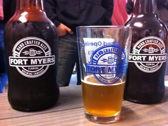 Growlers and a pint glass from Fort Myers Brewing Co.'s debut in March 2013.